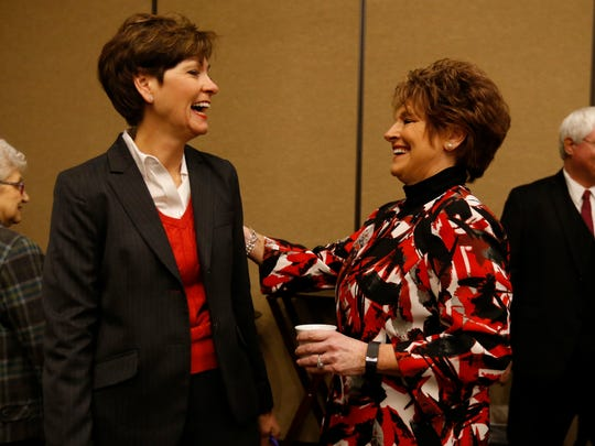 Lt. Gov. Kim Reynolds greets Rep. Linda Upmeyer on