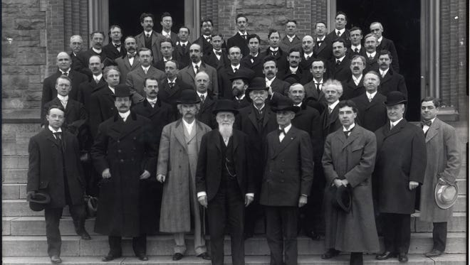 Mark Twain (left of center with a light-colored coat) poses with the Park Church League of Organists in front of the church.
