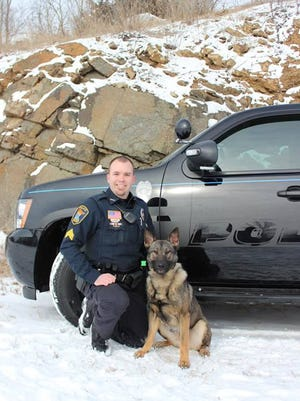 Cold Spring-Richmond Police Chief Jason Blum poses with Riley, the department's current K9 officer late last year. The team was involved in more than 60 narcotics searches last year.