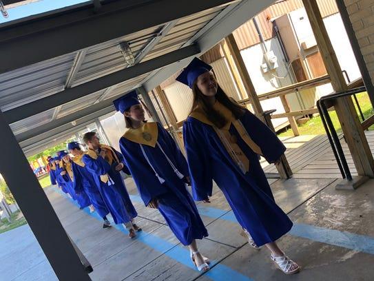 Graduating Rapides Parish seniors donned caps and gowns