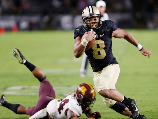 Markell Jones gets past Antonio Shenault of Minnesota for a touchdown with 1:17 remaining Saturday, October 7, 2017, at Ross-Ade Stadium. Purdue defeated Minnesota 31-17 in a game delayed by weather.