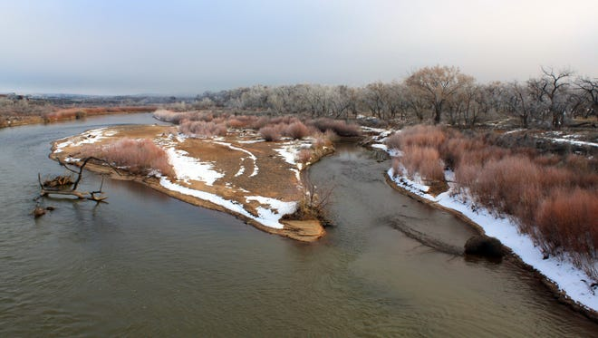 The banks of the Rio Grande are lined with snow on Dec. 30 as the river courses through Bernalillo, N.M. Above average precipitation in many parts of the state over the past year have helped erased short-term drought from New Mexico.