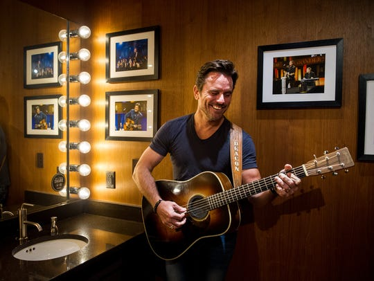 Charles Esten poses in his dressing room at the Grand