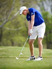 St. Cloud Cathedral's Will Freeman tees off on the