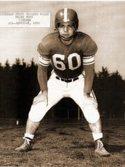 Frank Kush, a wiry, 5'7' 190-pound guard led the Michigan