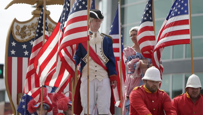 The Flag Day Parade marched through downtown Appleton Saturday for the 65th time.