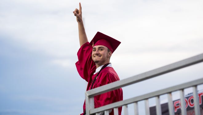 Vero Beach High School graduating senior Chase Bricker turns and smiles after walking across the stage at the Citrus Bowl during the class of 2018's commencement ceremony Friday, May 18, 2018, in Vero Beach.