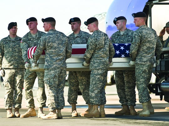 In this photo from 2011, a U.S. Army carry team transfers the remains of Fort Polk Spc. Omar Soltero at Dover Air Force Base, Delaware. Soltero was killed in an attack in Afghanistan. He is one of 95 Fort Polk soldiers to die in the Global War on Terrorism.