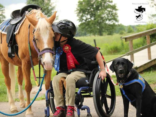 Bryan Rebimbas and therapy horse Penny at the annual