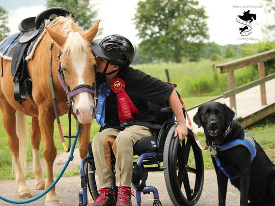 Bryan Rebimbas and therapy horse Penny at the annual Riding with HEART Fun Horse Show.