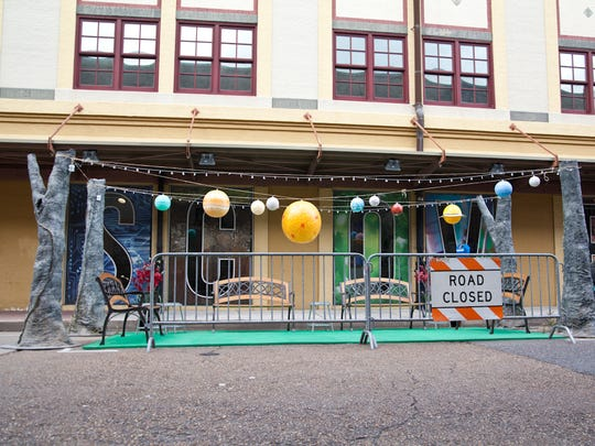 Planets hang above Lafayette Science Museum's Park(ing) Day public space. Several downtown parking spaces were transformed into small parks for Park(ing) Day, Sept. 15, 2017. Lafayette organizations participated in the global event where groups collaborate to transform metered parking spaces into temporary public places.