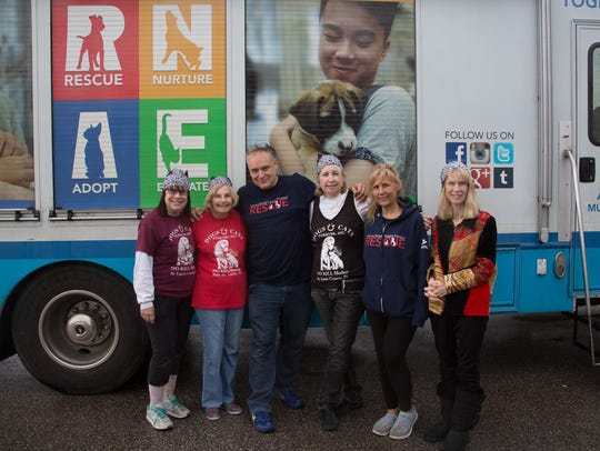 Dogs & Cats volunteers gather with NSALA staffers as
