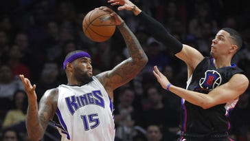 Mark J. Terrill/AP Kings center DeMarcus Cousins, left, grabs a rebound away from Clippers guard Austin Rivers during the first half Saturday in Los Angeles. Sacramento Kings center DeMarcus Cousins, left, grabs a rebound away from Los Angeles Clippers guard Austin Rivers during the first half of an NBA basketball game, Saturday, Jan. 16, 2016, in Los Angeles. (AP Photo/Mark J. Terrill)