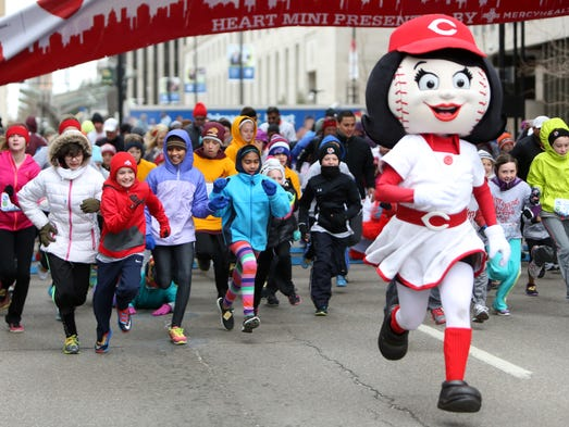 Rosie Red takes off at the starting line of the 2K Kids Mini MaraFun Run, as a part of the Cincinnati Heart Mini Marathon and Walk, benefiting the American Heart Association, on Sunday, March 16.