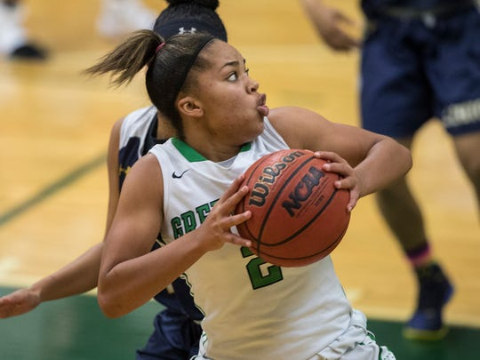 Jarya Outten, of Fort Myers High School makes a strong move to the basket as she drives by her defender during the game Friday evening against Lehigh Senior High School. Fort Myers won with a final score of 58-44.