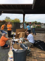 The Mission Team from Greencastle Presbyterian spent Freedom Sunday tidying up the old train station.