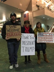 Cindy Spinnett, center, and her husband went to the Portland International Airport Sunday, Jan. 29, 2017 to voice their support for President Trump's executive orders banning certain immigrants and refugees. They met and befriended protesters who strongly opposed the orders.