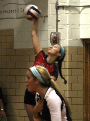 """St. Henry senior Kendyll Kraus (serving) was named Touchstone Energy All """"A"""" Classic state tournament MVP."""