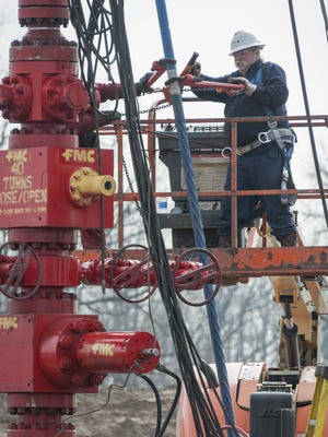 A crew prepares to hydraulically fracture — or frack — an oil and gas well in northwestern Ashland County.