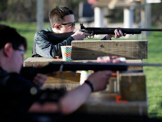 Khain Thiessen, 12, of Toledo, Iowa, shoots during
