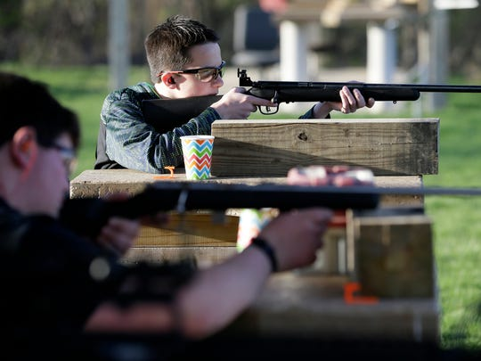 Khain Thiessen, 12, of Toledo, Iowa, shoots during