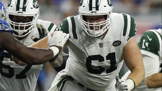 New York Jets center Spencer Long (61) sets to block against the Detroit Lions during an NFL football game in Detroit, Monday, Sept. 10, 2018. (Jeff Haynes/AP Images for Panini)