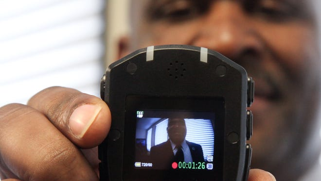 In this file photo, Monroe Police Department Chief Quentin Holmes gives a demonstration using the new body cameras five officers will wear through May. A bill that would have exempted all footage from the Louisiana public records laws was heavily amended in a Senate committee here Tuesday.