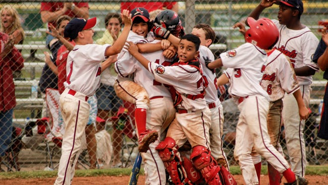 "A photo from the ""Hometown Teams: How Sports Shape America"" exhibit shows youngsters celebrating a walk-off home run. The exhibit opens Saturday at the Southern Forest Heritage Museum in south Rapides Parish."