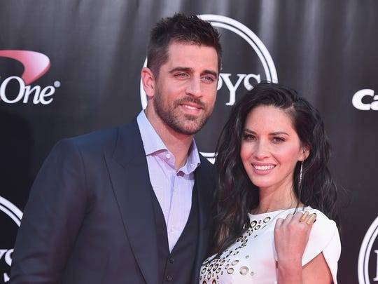NFL player Aaron Rodgers and Munn  are seen together