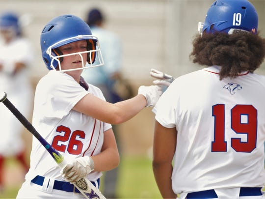 Cooper's Maddie Mansker (26) is congratulated by Jada Willis after scoring on Camille Scott's double in the first inning. Cooper beat the Maidens 10-0 in six innings Tuesday, April 17, 2018 at Cougar Diamond.