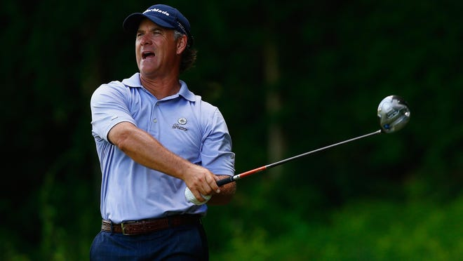 CROMWELL, CT - JUNE 19: Scott McCarron of the United States watches his tee shot on the 15th hole during the first round of the Travelers Championship golf tournament at the TPC River Highlands on June 19, 2014 in Cromwell, Connecticut. (Photo by Jared Wickerham/Getty Images)