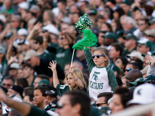 MSU football fans cheer on the Spartans Saturday, Oct.