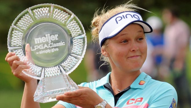 Brooke Henderson poses with the trophy after winning the Meijer LPGA Classic golf tournament at Blythefield Country Club. Sunday, June 18, 2017, in Grand Rapids.