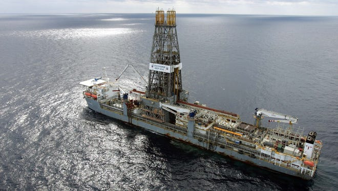 In this March 28, 2006 file photo, the Discoverer Deep Seas drillship sits on station off the coast of Louisiana as Chevron drills for oil in the Gulf of Mexico.  Congress is renewing its call to open U.S. coastal waters to oil and gas development, arguing that it's high time to battle high prices with increased domestic production.