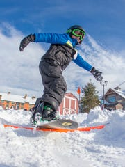 Mountain Creek and Burton team together to offer indoor gym sessions at schools in the area where kids work on balance and flexibility to make the transition to riding on snow easier.