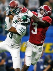 Former Michigan State football player Jermaine Edmondson, left, played for the Spartans from 2013-15. He redshirted his freshman season.