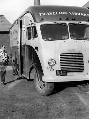 Ready to Roll - Earl Kanada takes final look around Monroe County Traveling Library Bookmobile before setting off on first lap of a seven-hour journey. (The bookmobile was retired from use in 1962.)