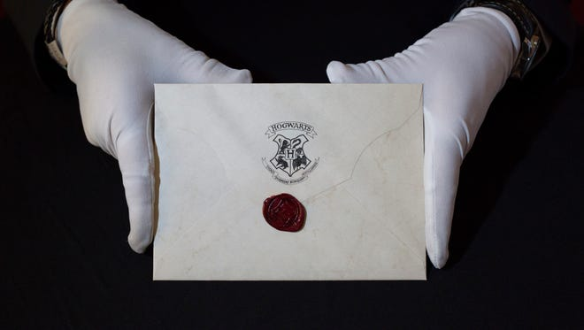 Harry Potter Hogwarts Acceptance Letter with Wax Seal from Harry Potter and the Philosopher's Stone (2001). (Photo by John Phillips/Getty Images)