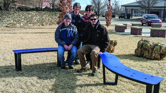 Thomas Derstein, Judi Kirk, Michelle Somaduran and Colin Seacat took time out last Saturday to try out a new bench the Public Arts Committee installed at the Starlight Park in Greensburg.