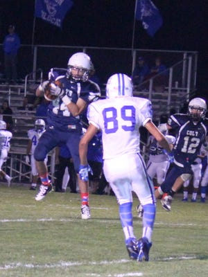 Silver's Shawn Gutierrez caches this pass and takes it to paydirt during fourth quarter action against Lovington. It proved to be the game winner and give the Colts a 7-6 win.