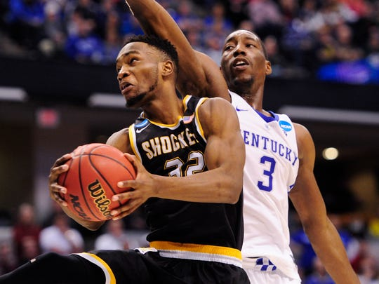 Wichita State's forward Markis McDuffie drives past