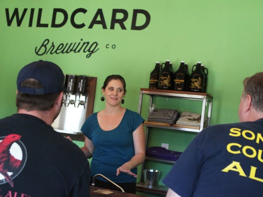 Jenny Hansen, CEO of Wildcard Brewing, talks to customers at the brewery's headquarters in east Redding.