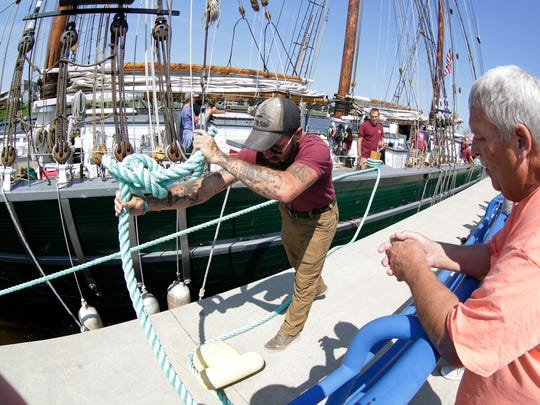 Denis Sullivan First Mate Jonny Slanga ties a rope to secure the three-mast ship near south pier Tuesday August 15, 2017 in Sheboygan, Wis.