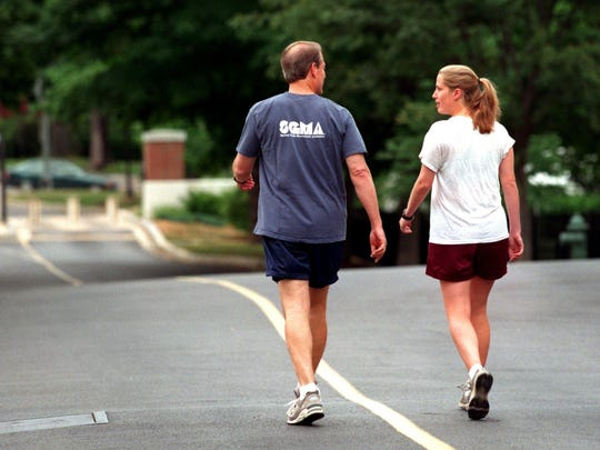 Vice President Albert Gore Jr and his daughter Kristin share a private moment before the begin jogging on the grounds of the Naval Observatory where the Vice President's home is located in Washington DC. Kristin just graduated from Harvard..