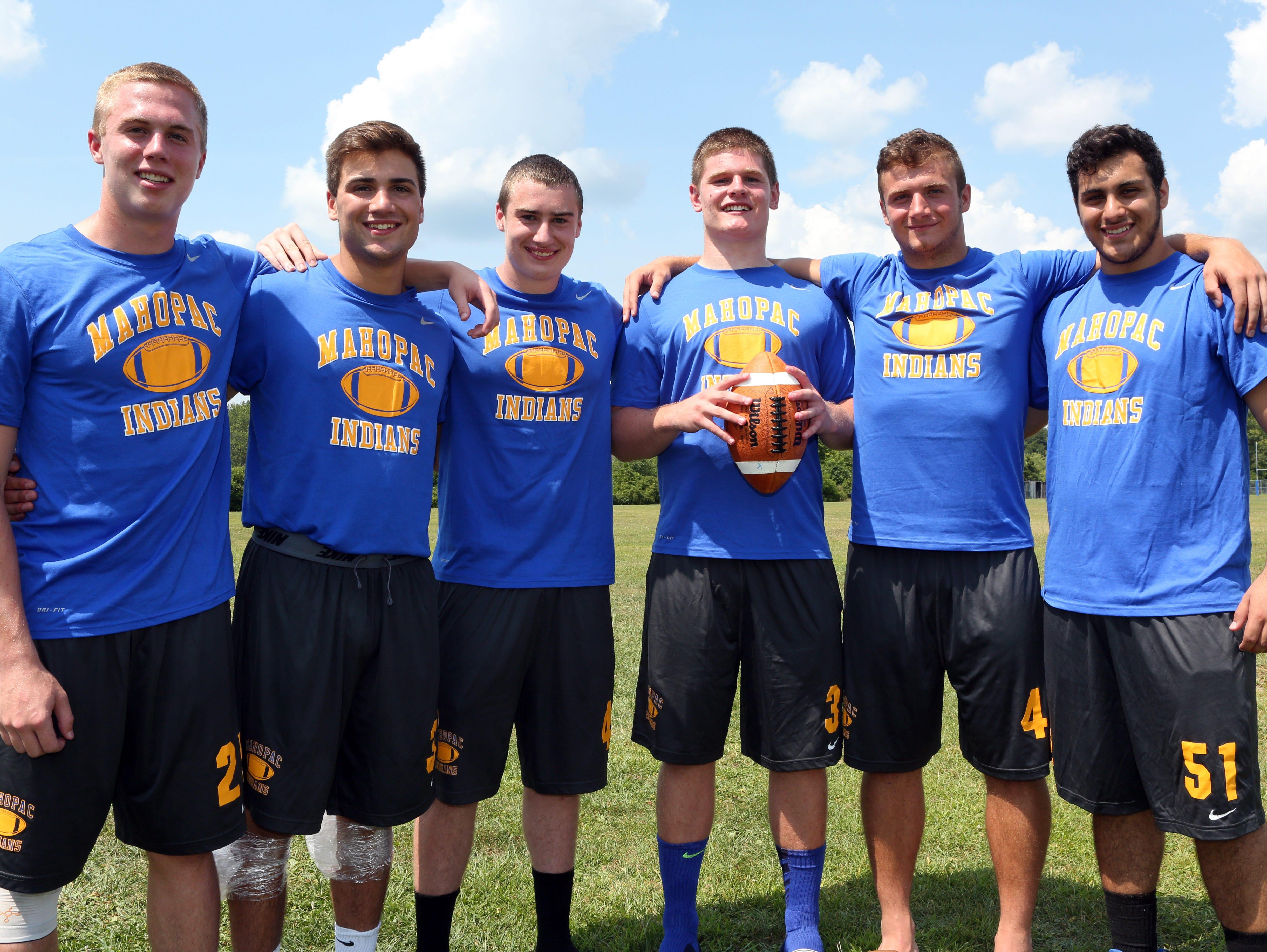 Mahopac varsity football players from left, Christian Donahoe, Joseph Cavaciuti, Tom Murray, Dan Foley, Chris Kocovic and Mike Paolello pose at Mahopac High School Aug. 17, 2015.