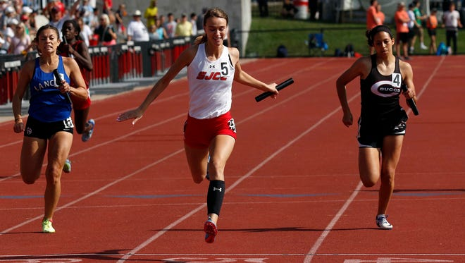 St. Joseph Central Catholic's Jessica Drown smiles as she crosses the finish line in first place during the 800 meter relay Saturday, June 2, 2018, during the state track and field championship at Jesse Owens Memorial Stadium in Columbus.