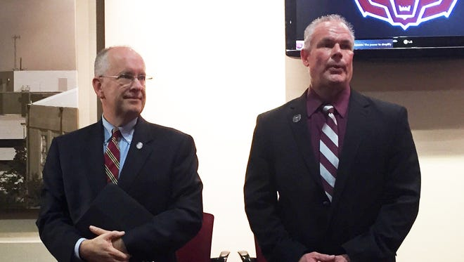 Missouri State president Clif Smart stands besides new MSU football coach Dave Steckel