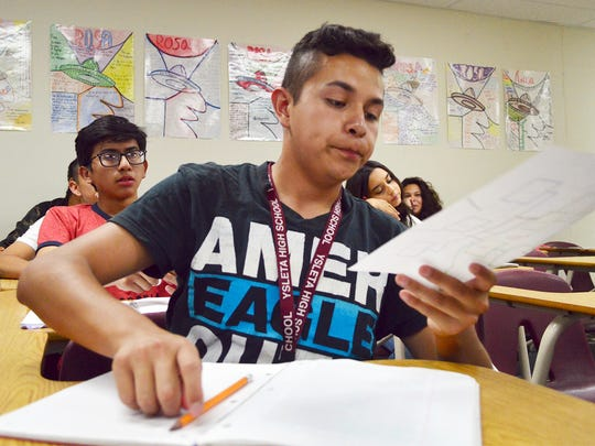 Steve Alvarado, a freshman at Ysleta High School, works on an assignment in his Spanish Class on Friday.