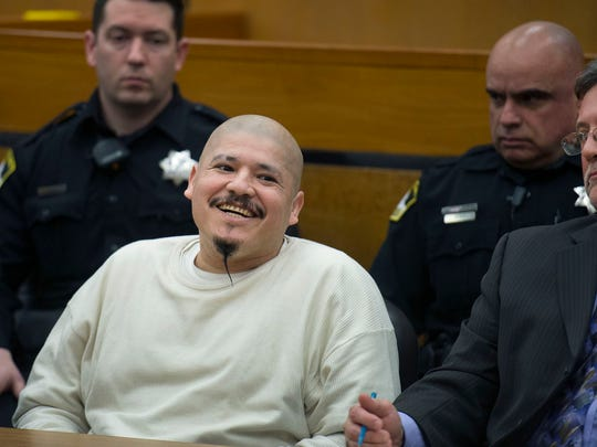 Luis Bracamontes smiles as the verdict is read that he will receive the death penalty in the murders of Deputy Danny Oliver and Detective Michael Davis Jr. in Sacramento.