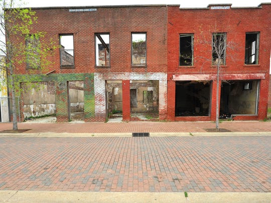 Redevelopment strategies for the historic Farish Street District have proven problematic for the administrations of multiple mayors though residentsfrustrated with outside promises have begun their own quiet revival.